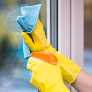 Cleaning window with spray and towel