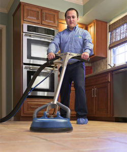 ServiceMaster Restore cleaning tile in kitchen