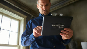 ServiceMaster Restore Rep on tablet